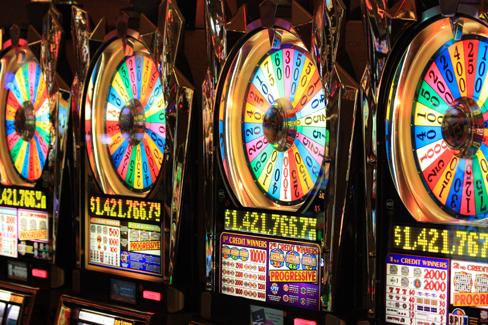 Gambling. A photograph shows four digital gaming machines.