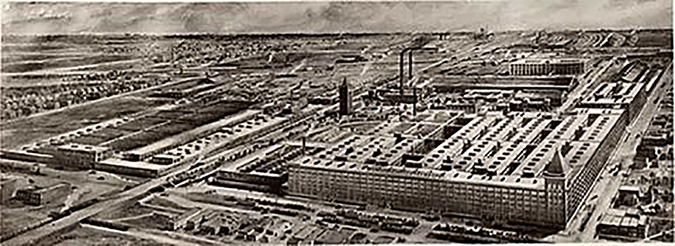A black-and-white photo shows an aerial view of the Hawthorne Works, a large factory complex consisting of several buildings.