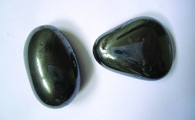 Two rounded, smooth black stones are shown.