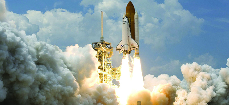 This is an image of a space shuttle blasting off into space.