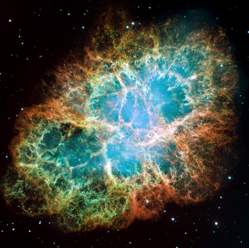 Image of the Crab Nebula Supernova Remnant. An oblong region of diffuse light, with delicate wisps and tendrils of gas, are seen expanding outward into the blackness of space.
