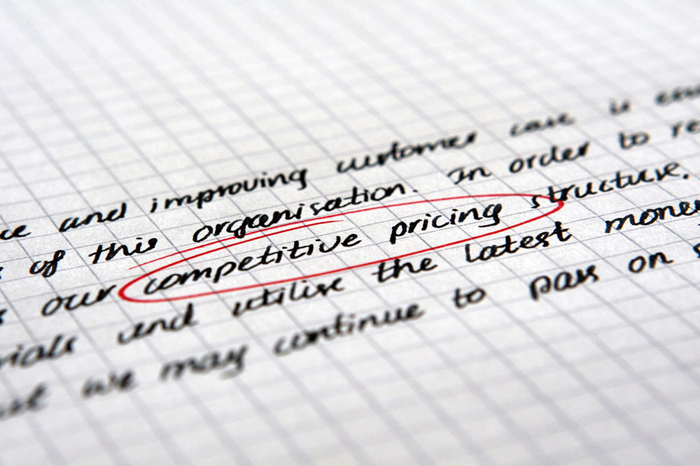 "A photo shows the words ""competitive pricing"" circled on a piece of paper."