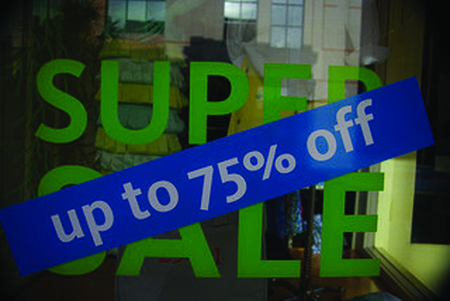 The figure shows a sale sign with a discount rate