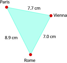 "This is an image of a triangle. Clockwise beginning at the top, each vertex is labeled. The top vertex is labeled ""Paris"", the next vertex is labeled ""Vienna"", and the next vertex is labeled ""Rome"". The distance from Paris to Vienna is 7.7 centimeters. The distance from Vienna to Rome is 7 centimeters. The distance from Rome to Paris is 8.9 centimeters."