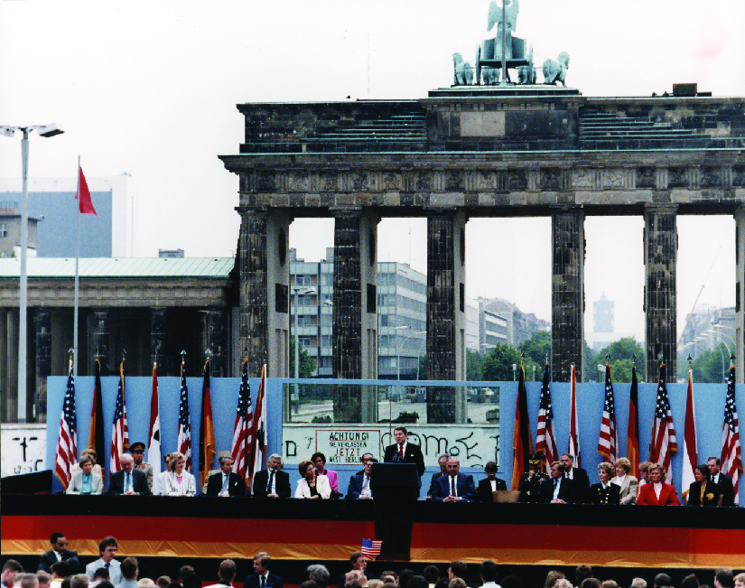 A photo of Ronald Reagan giving a speech in Berlin.