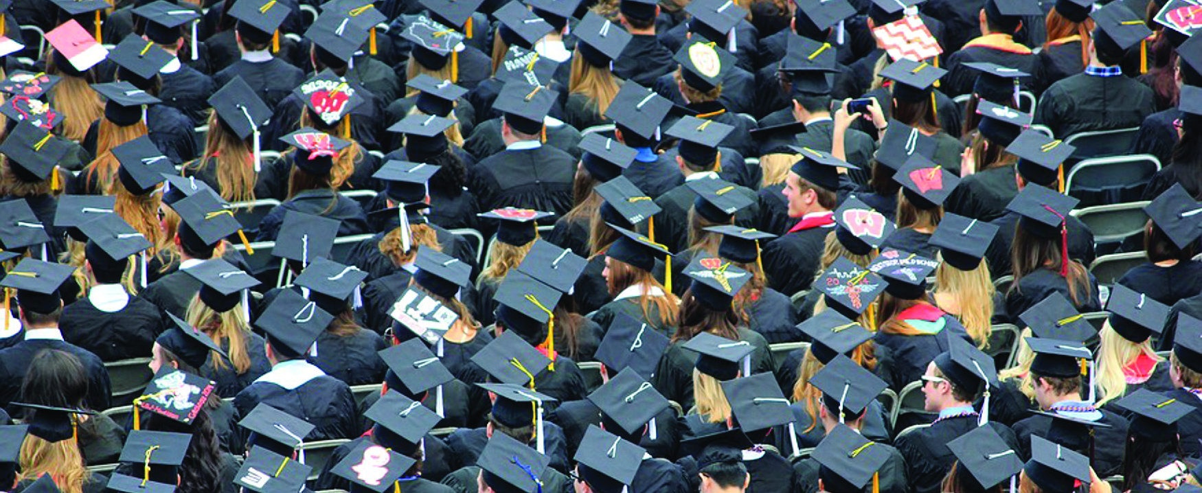 Photo of graduates in caps and gowns.