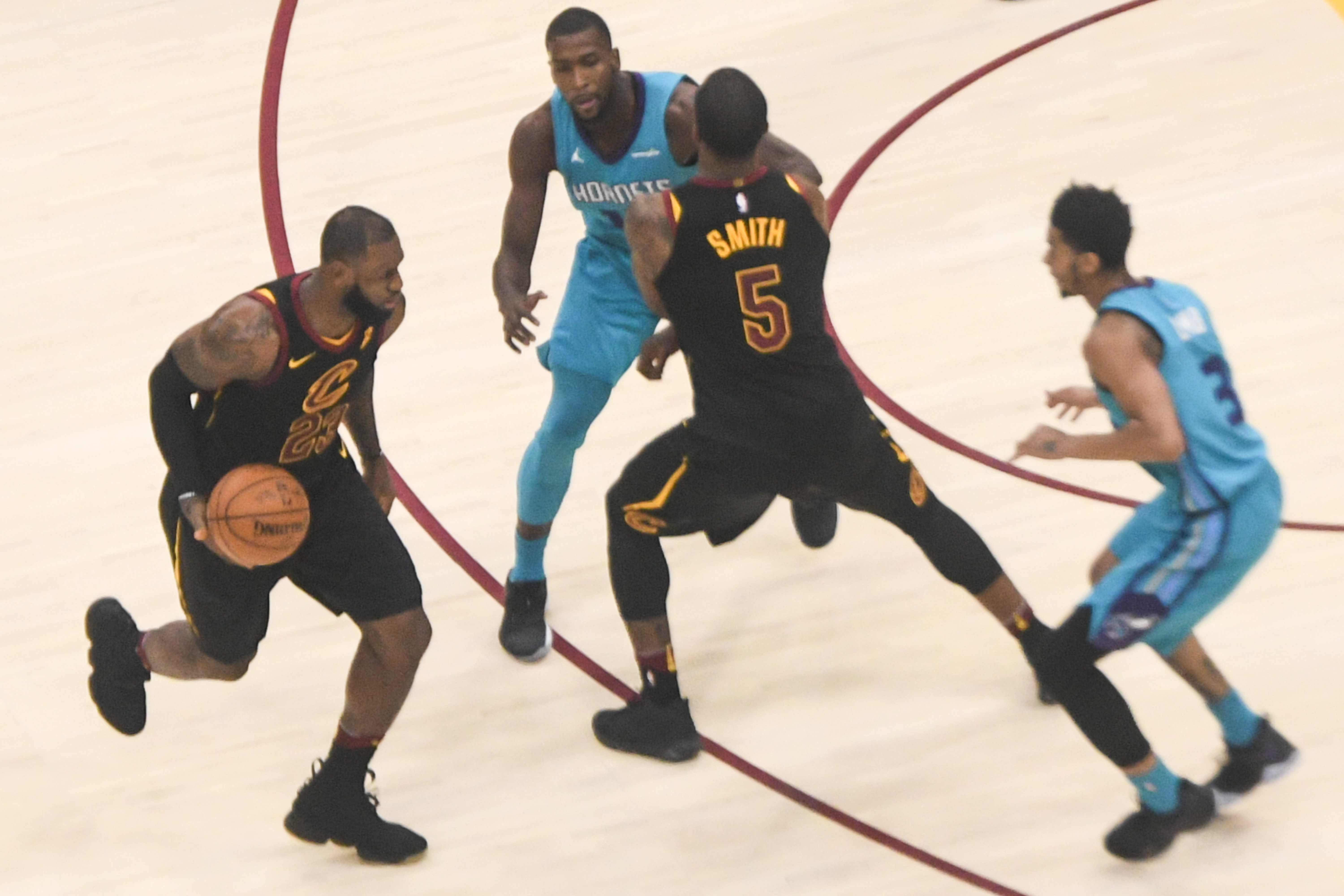 A photograph shows LeBron James dribbling a basketball during a basketball game