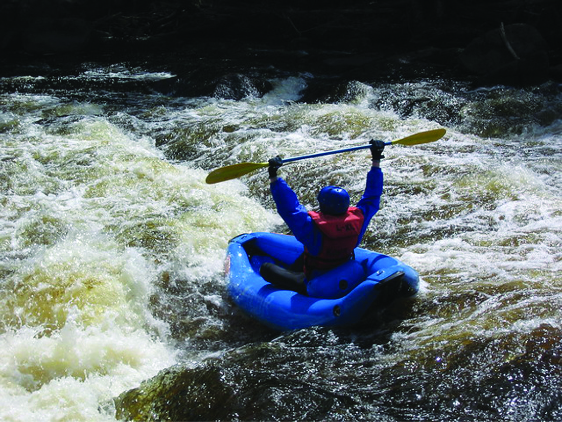 Photo of a person white-water rafting.