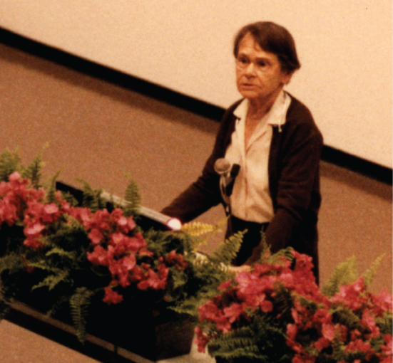 A photo shows Barbara McClintock giving her Nobel Lecture.