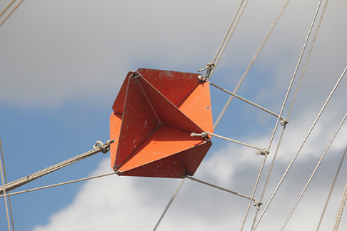 A photograph of a radar reflector on the rigging of a sailboat.