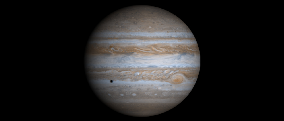 Image of Jupiter taken by the Cassini spacecraft. The alternating light and dark cloud bands are clearly seen, as is the Great Red Spot. At lower left, below the equator, the shadow of one of Jupiter's moons is projected onto the cloud tops.