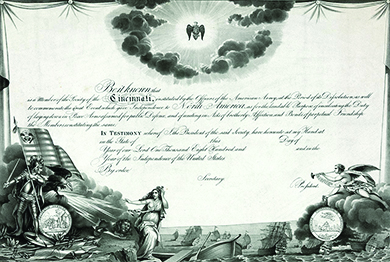 "A membership certificate for the Society of the Cincinnati is shown. The language on the certificate commemorates ""the great Event which gave Independence to North America."""