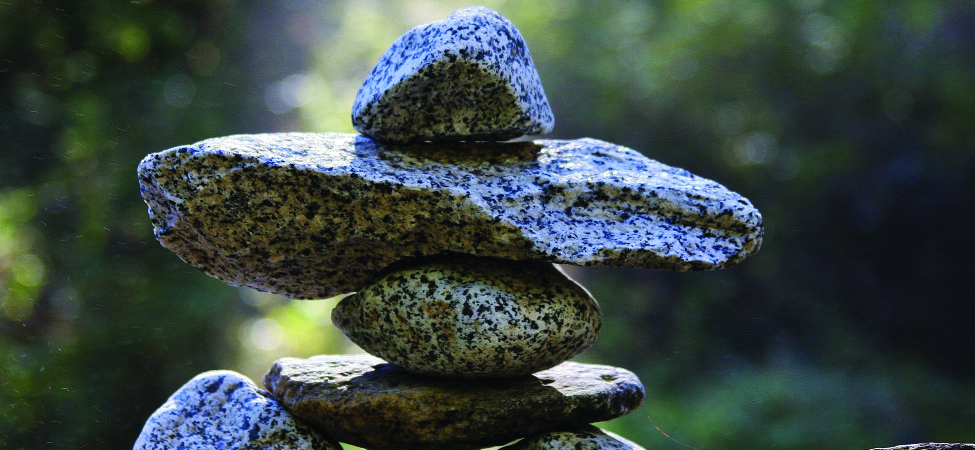 This is a photo of several rocks carefully stacked to achieve balance.