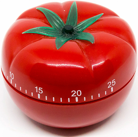 A Pomodoro kitchen timer, resembling a tomato with a scale marked on its body.