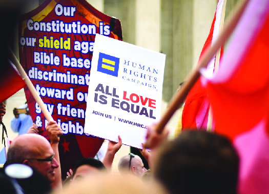 "An image of a sign reading ""Human rights campaign all love is equal""."