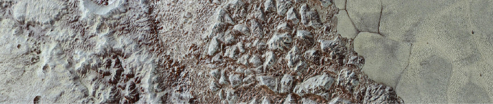 "An image of a strip of Pluto's terrain, showing an area with a few craters on the left, mountains in the center, and a flat ""sea"" on the right."