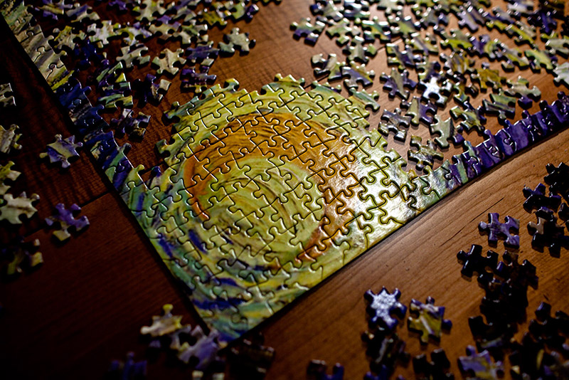 A photo shows the overhead view of an incomplete jigsaw puzzle with hundreds of pieces.