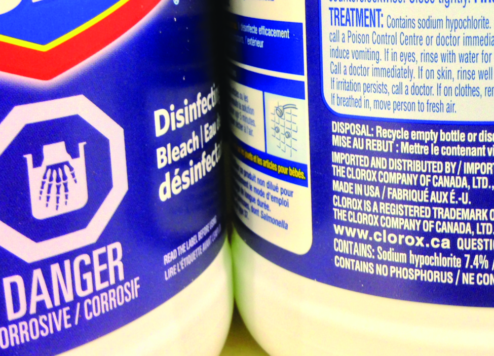 "The sides of two cylindrical containers are shown. Each container's label is partially visible. The left container's label reads ""Bleach."" The right label contains more information about the product including the phrase, ""Contains: Sodium hypochlorite 7.4 %."""