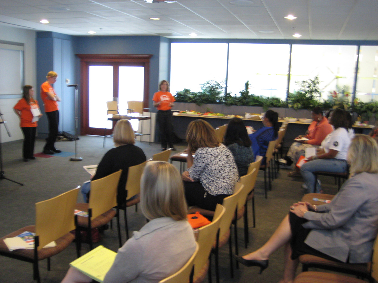 A photo shows the Northern Trust Bank staff watching a presentation presented by the Disability Awareness Players.