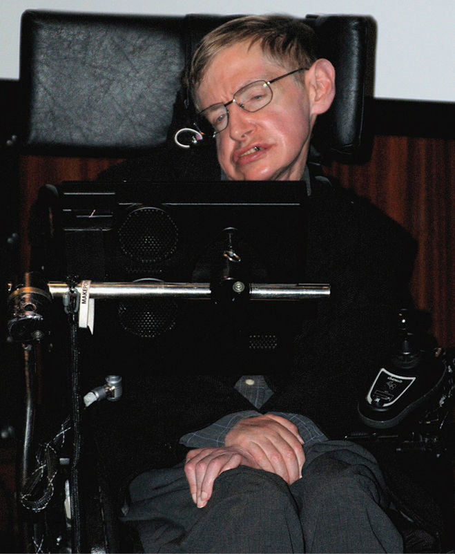 A picture showing the famous physicist Stephen Hawking in his wheelchair with his keyboard he uses to communicate.