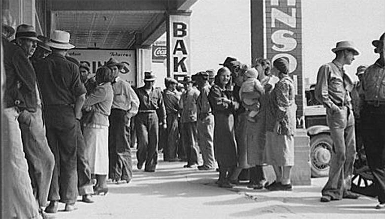 The photograph shows people lined up outside a bank during the Great Depression awaiting their relief checks.
