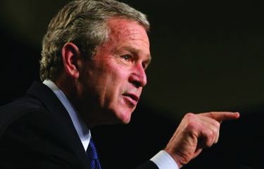 An image of George W. Bush in profile, pointing his finger to the right.