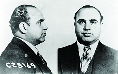 A mug shot shows front and side views of Al Capone.