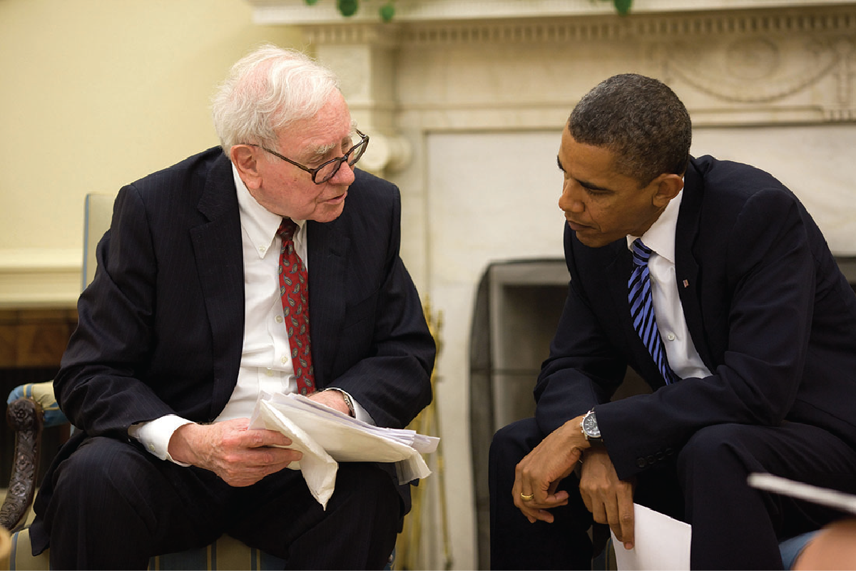 An image of Warren buffet on the left and Barack Obama on the right. Both are seated and facing each other.