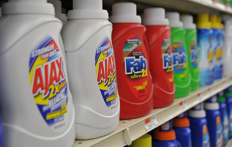 Image of bottles of laundry detergent on a store shelf.