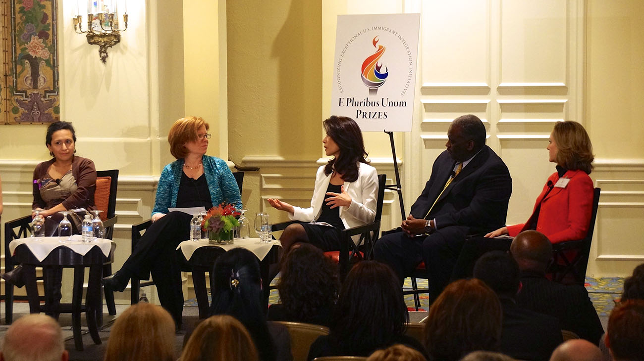 A photo shows a diverse team of experts of Kaiser Permanente participating in a panel discussion during the E Pluribus Unum Prizes Ceremony.