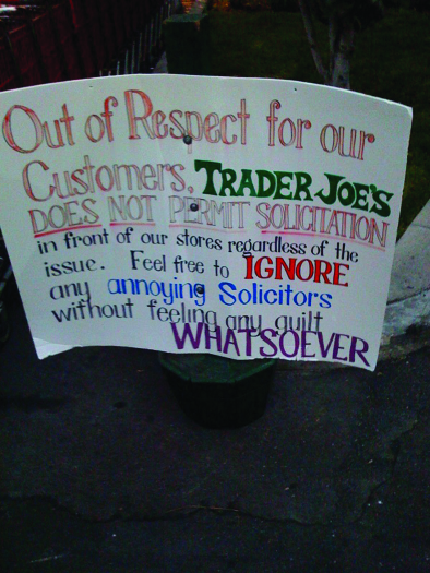 "A photo of a sign. The sign reads ""Out of respect for our customers, Trader Joe's does not permit solicitation in front of our stores regardless of the issue. Feel free to ignore any annoying solicitors without feeling any guilt whatsoever""."