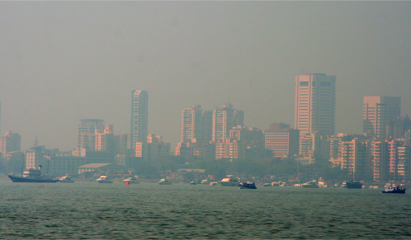 Photo of a city skyline clouded by smog.