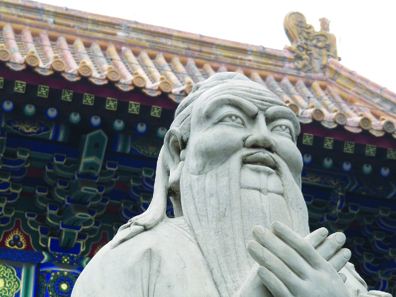 A photo of a statue depicting Confucius that is in front of the Confucius Temple.