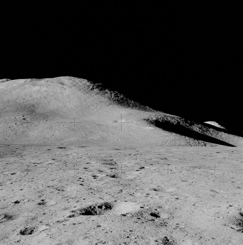 Photograph of a Lunar Mountain. The smooth contour of Mt. Hadley is seen against the inky blackness of space.