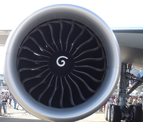 Picture is a photo of an air turbine under the wing of an airplane.