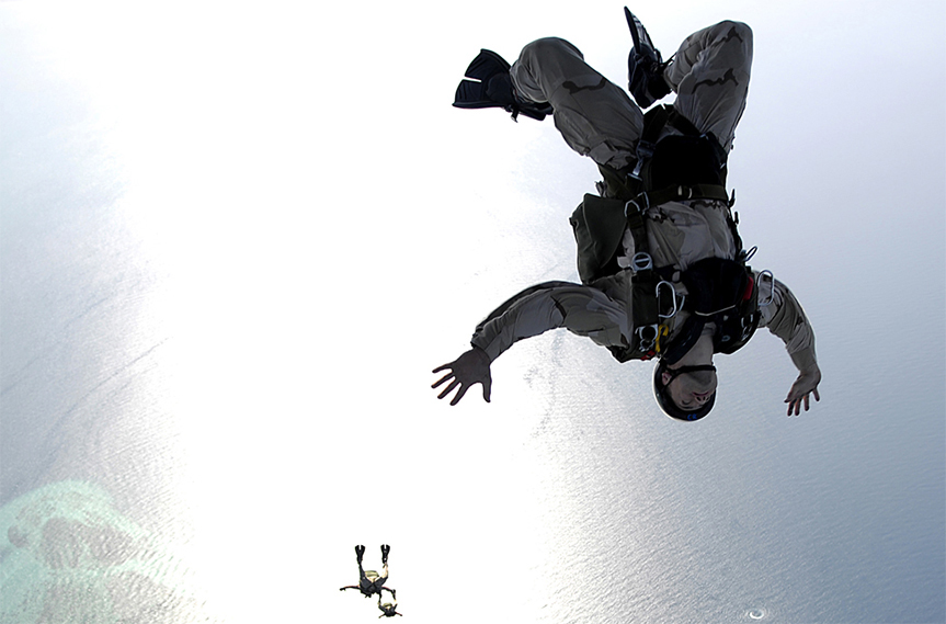 Two skydivers free falling in the sky.