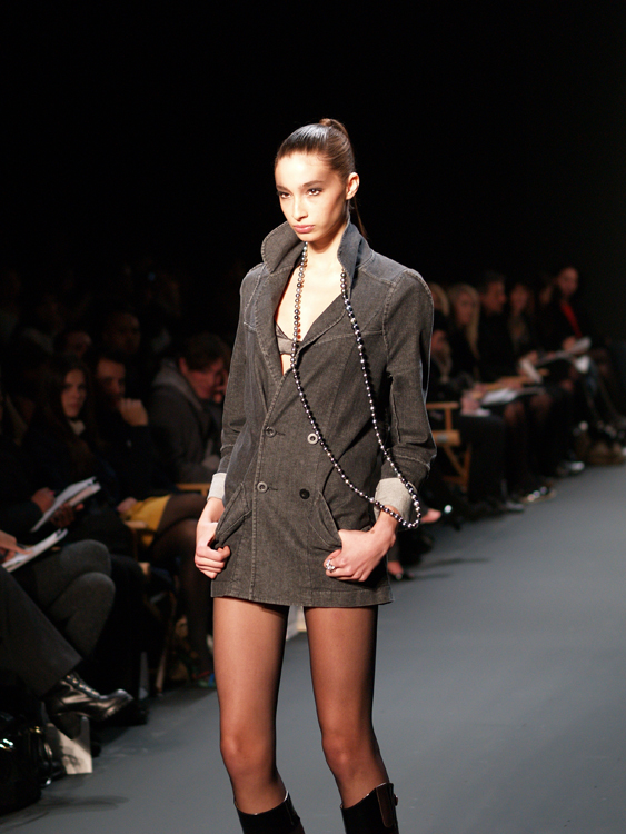 A thin female model is shown participating in New York's fashion week.
