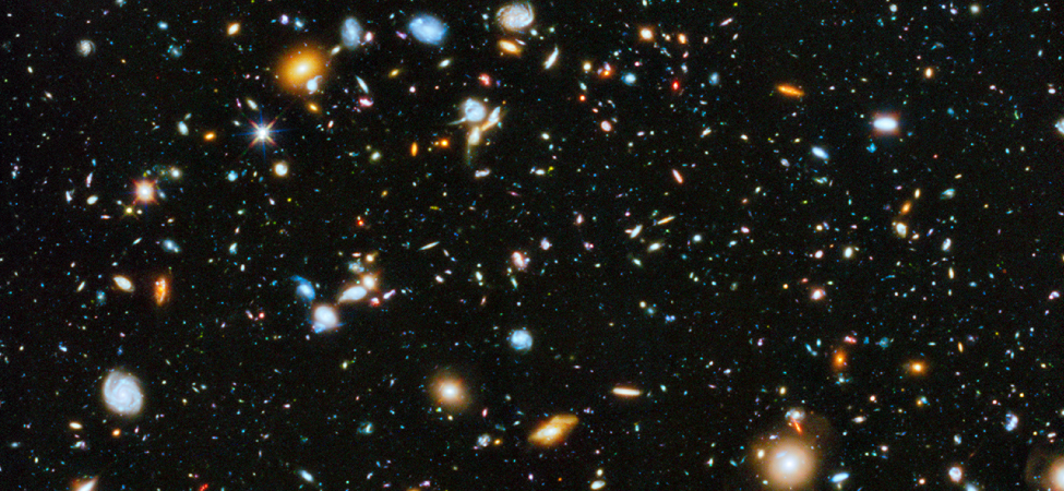 A photo of a telescope image showing many galaxies and stars