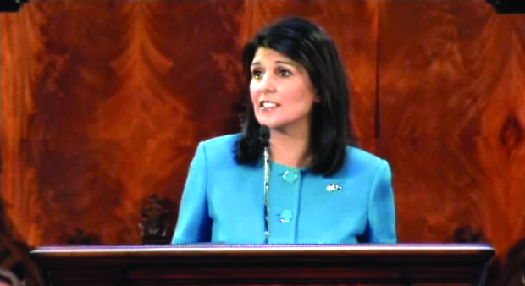 An image of Nikki Haley standing behind a podium.