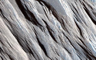 Martian wind erosion. The long, straight wind-blown ridges cross this image from the upper left to the lower right.