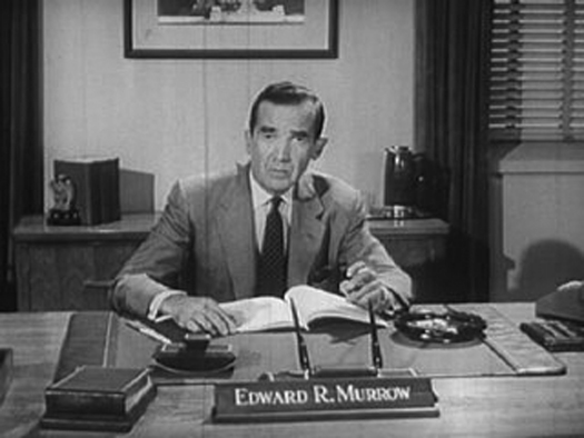 An image of Edward R. Murrow seated behind a desk.