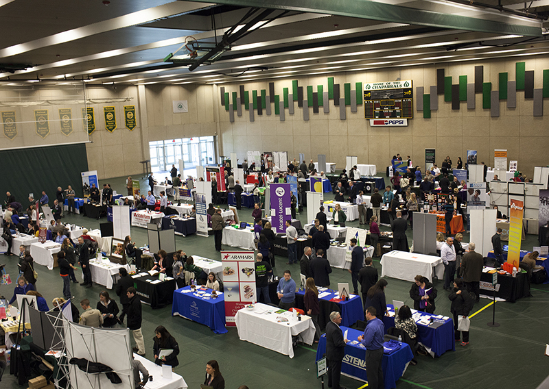 A photo shows job seekers and employers participating in the College of DuPage's third annual Career Fair.
