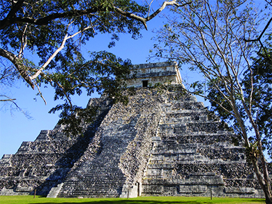 A photograph shows El Castillo, a stepped pyramid with a set of wide stone steps running up the front and a square structure with an entryway on top.