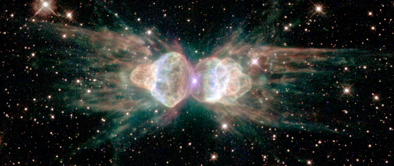 "False-color Image of the Ant Nebula. This ""planetary nebula"" consists of a central star (located at the center of this image), bracketed on the left and right by two lobes of gaseous material. The image is colored such that red corresponds to sulfur emission, green to nitrogen, blue to hydrogen, and blue/violet to oxygen."