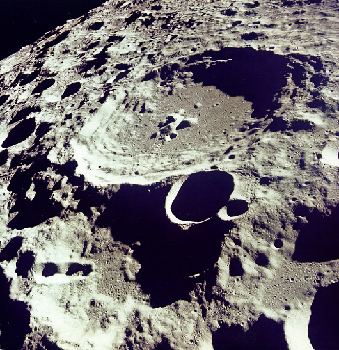 Photograph of Lunar Highlands. This image is dominated by countless overlapping craters of all sizes, which is typical of the Lunar highlands.