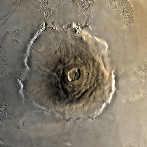 An overhead image of the volcano Olympus Mons on Mars, with a crater at the top.