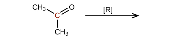 The left side of a reaction and arrow are shown. The arrow is labeled with an R in brackets. To the left of the arrow is a molecular structure that shows a central, red C atom. This C atom is bonded to 2 C H subscript 3 groups, and it forms a double bond with an O atom.