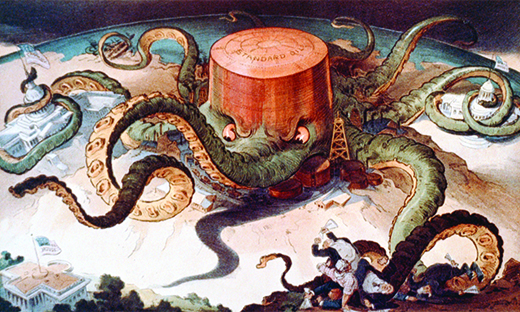 "A cartoon shows a massive octopus labeled ""Standard Oil."" The octopus's tentacles wrap around a series of tiny buildings and structures, indicating that it controls the steel, copper, and shipping industries; the U.S. Capitol; and a state house. A final tentacle seeks the White House, but has not yet reached it."