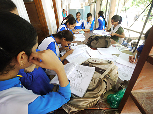 A photograph shows students studying.