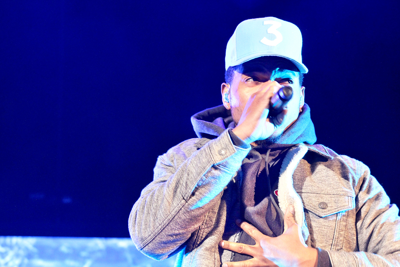 A photograph shows Chance the Rapper on stage with a microphone.